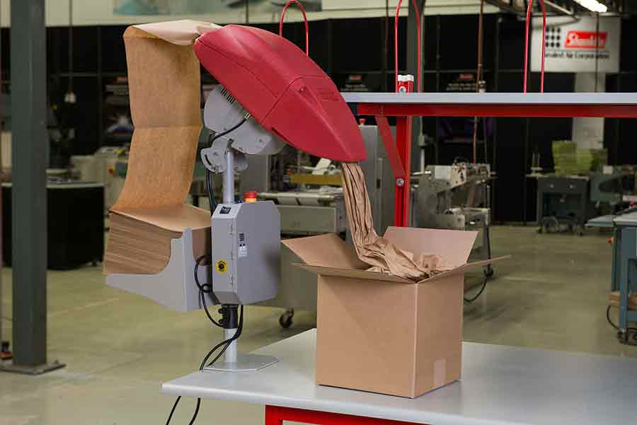 Machine stuffing packaging paper into box